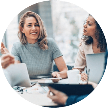 Employee Smiling While Discussing in the Meeting