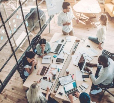 Young Employees Working Together In Modern Office Space